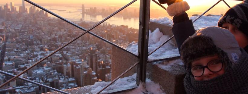 empire state building hiver neige new york enfant coucher de soleil